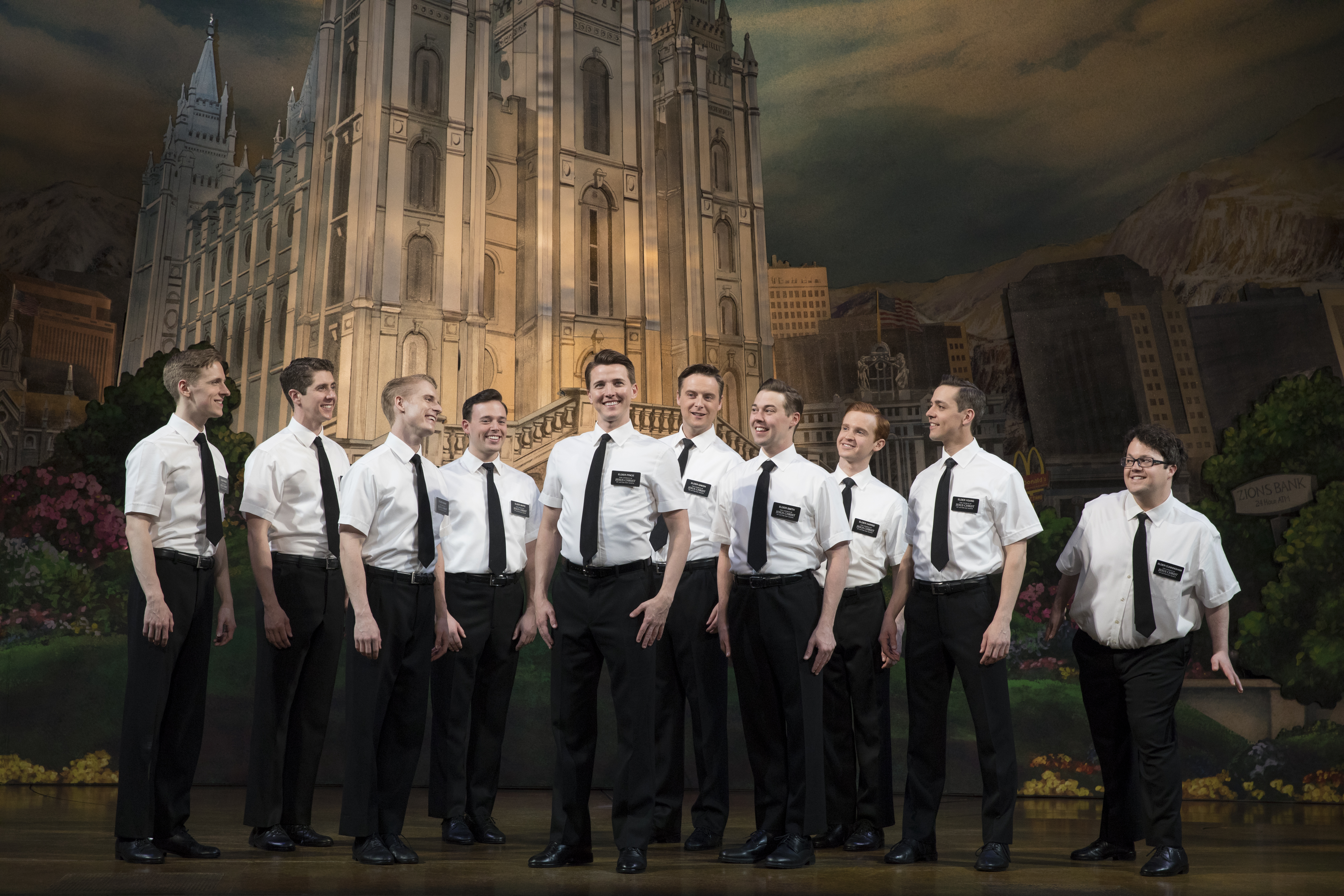 NEW-Dave-Thomas-Brown-as-Elder-Price-center-Cody-Jamison-Strand-as-Elder-Cunningham-far-right-and-company-in-The-Book-of-Mormon-452.jpg