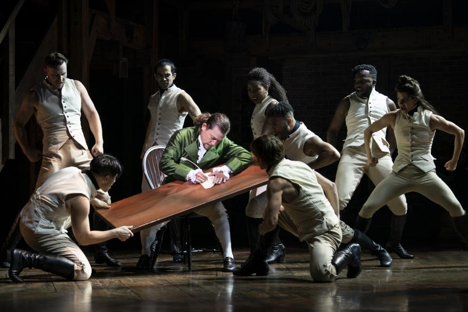8.-Miguel-Cervantes-and-the-ensemble-of-HAMILTON-HAMILTON-c-Joan-Marcus-2021.jpg